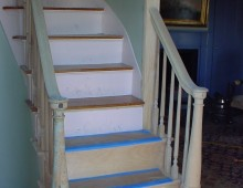 This is a stairway in Portsmouth, New Hampshire. The turnings on the right are copies made to match the other side after an abutting wall was taken down.
