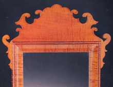 This is a classic Chippendale mirror.