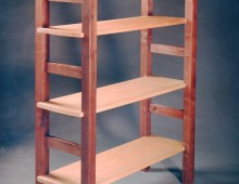 This is a simply designed walnut bookcase. It has open, ladder-style sides.