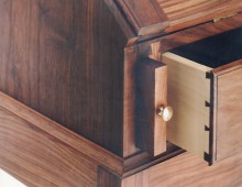 This is a detail of a captain's, or secretary, desk. The small interior drawers have brass pulls and dovetail joints.