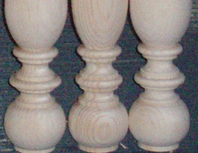 These are details of turnings done in pine. These have very rounded components near their base.