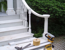 These are exterior porch rails with turn-out volutes. This is a grand porch graced by columns and leading directly onto a stone drive.