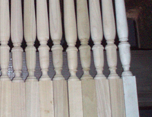 The process of creating multiple custom stair spindles is shown here. The spindle to the far right is the design upon which the other copies are made.