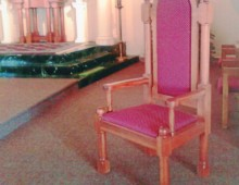 This is an altar chair from the St. James Catholic Church in Portsmouth, New Hampshire. This is only one example of the furniture completed for the church.