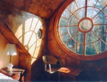 This is an awe-inspiring custom circular window gracing a stucco house in Cape Neddick, Maine. The window is pictured in its several phases before, during and after installation.