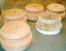 This is a set of four column bases made for Historic New England, a preservation organization. The base in the right foreground is the period original upon which four copies were designed and produced.